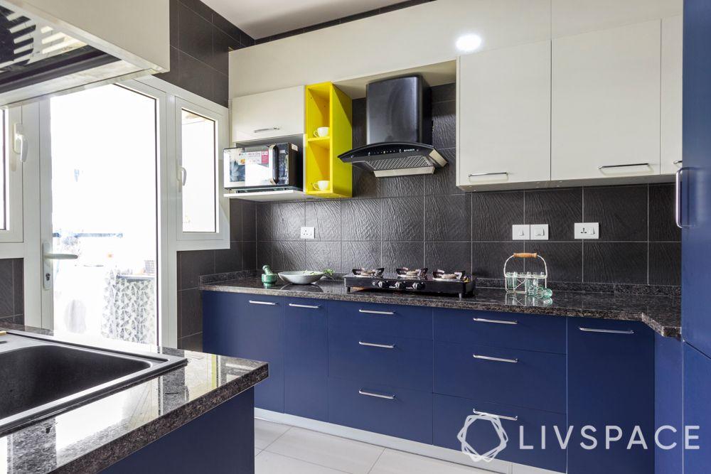 simple kitchen design-blue cabinets-black backsplash
