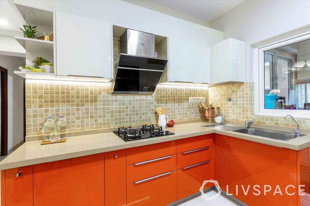 small kitchen design Indian style-orange cabinets-backsplash