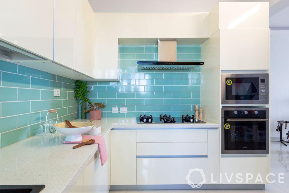 simple kitchen design-pearl white cabinets-cyan blue backsplash