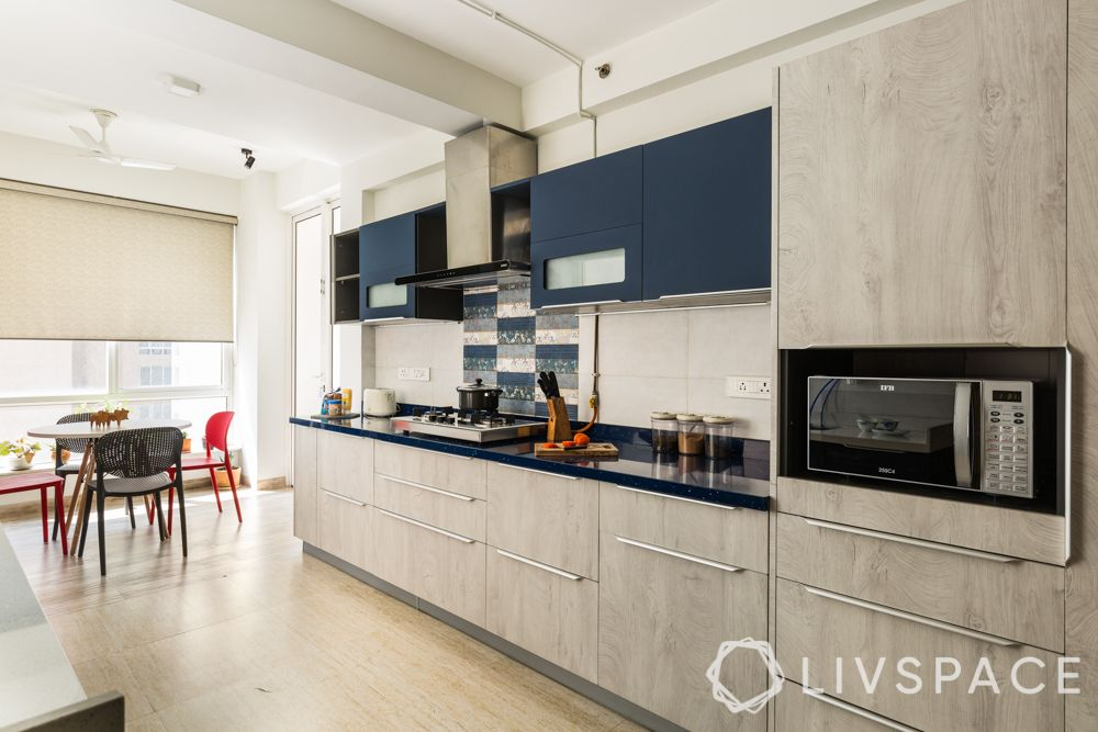 small kitchen design Indian style-wooden base cabinets-blue upper cabinets-open kitchen