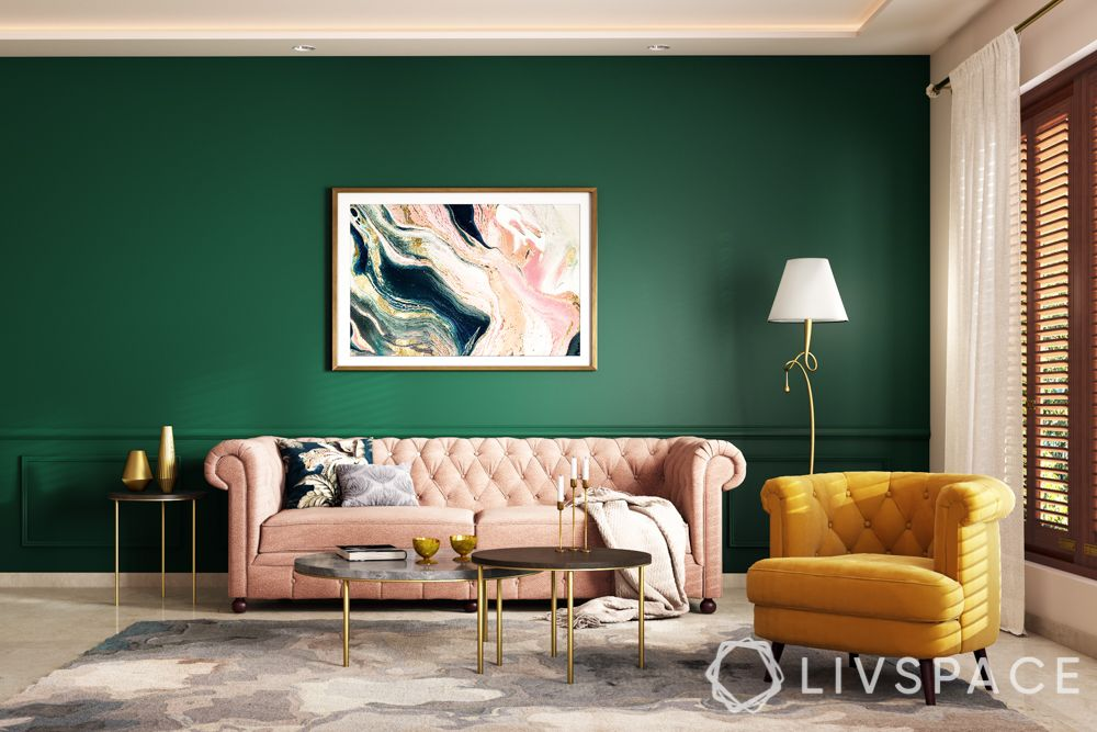 paint trends 2021-bottle green wall-pink sofa