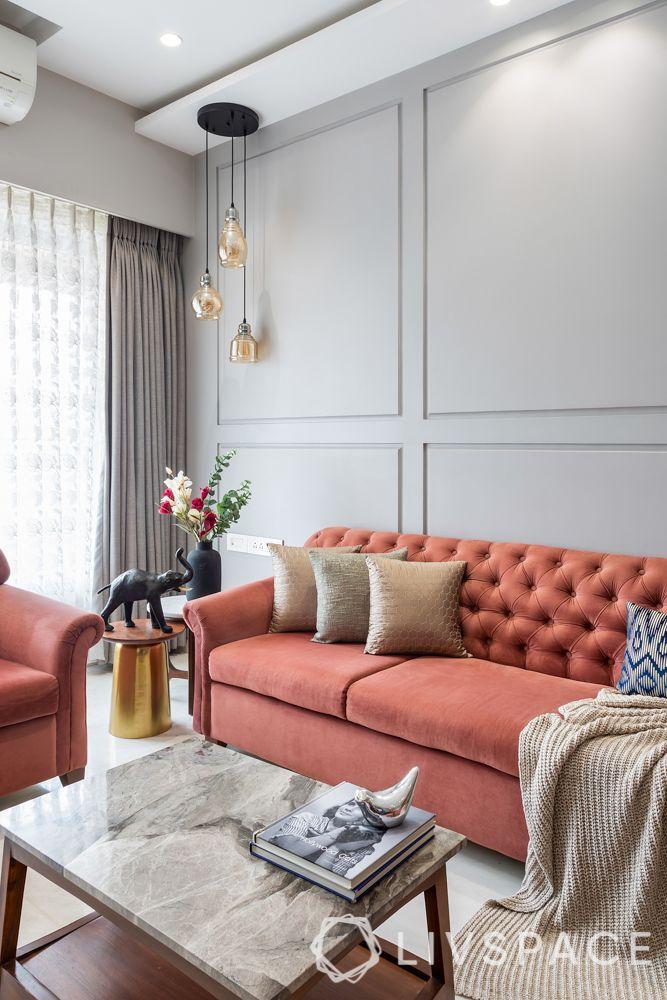 pendant lights-pastel sofa-grey walls
