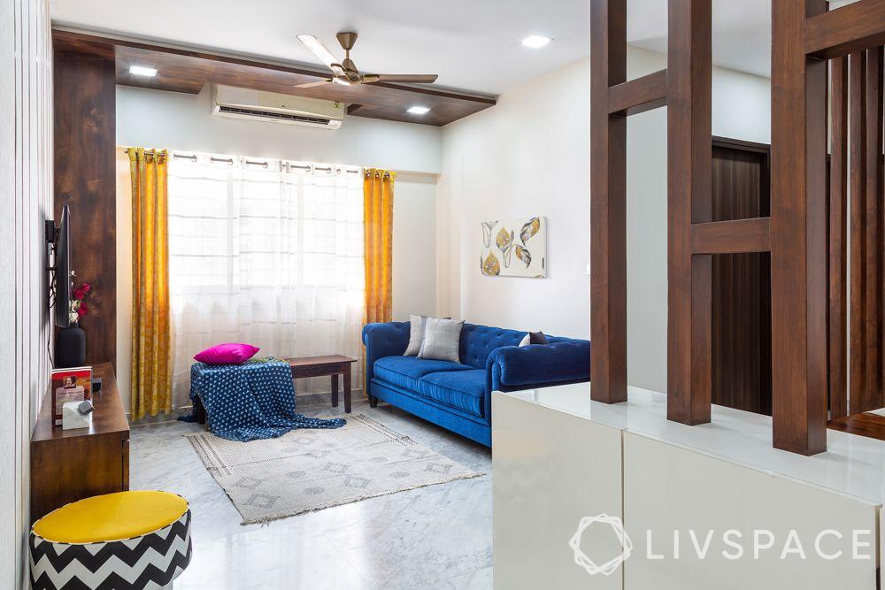 contemporary interior designer-living room-blue sofa-pops of yellow
