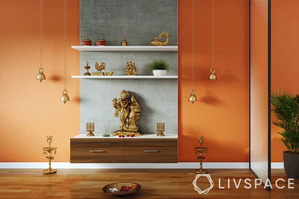 devghar design-pooja unit-orange background-hanging bells-diyas