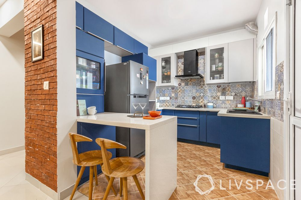 blue kitchen-breakfast counter-brick wall