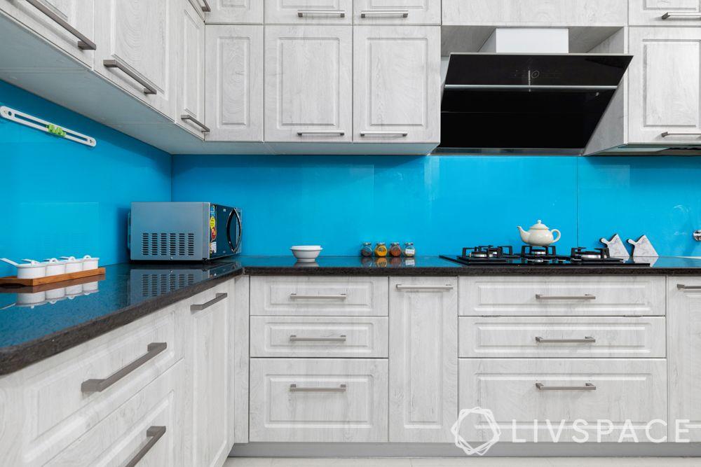 kitchen design-blue backsplash-distressed cabinet finish