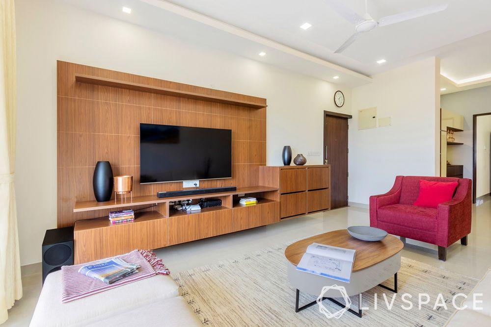3bhk in bangalore-tv unit design-red armchair