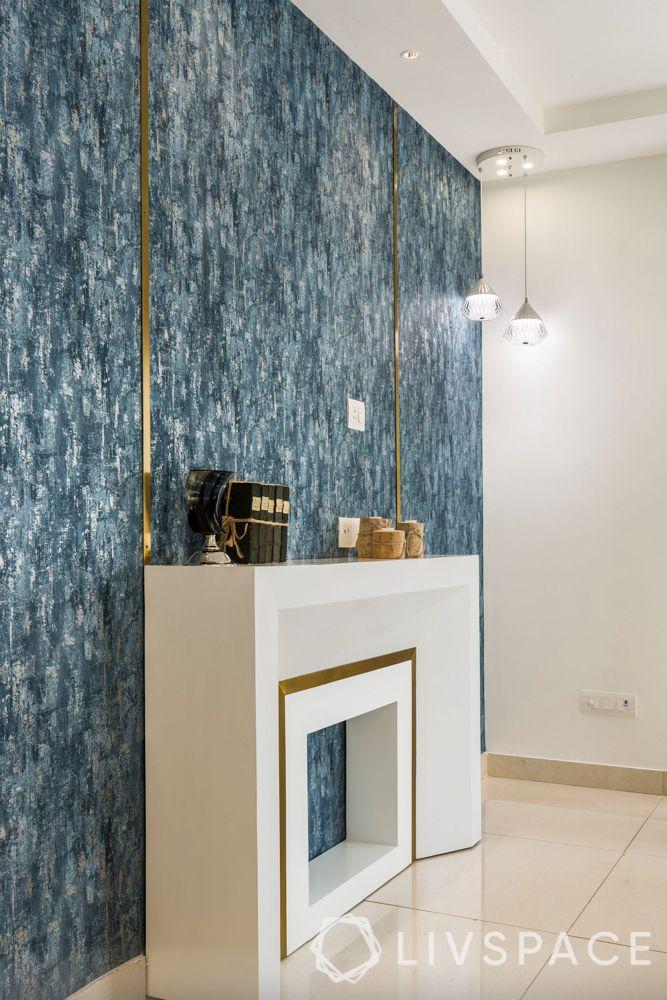 house maintenance-blue textured wallpaper-gold trims