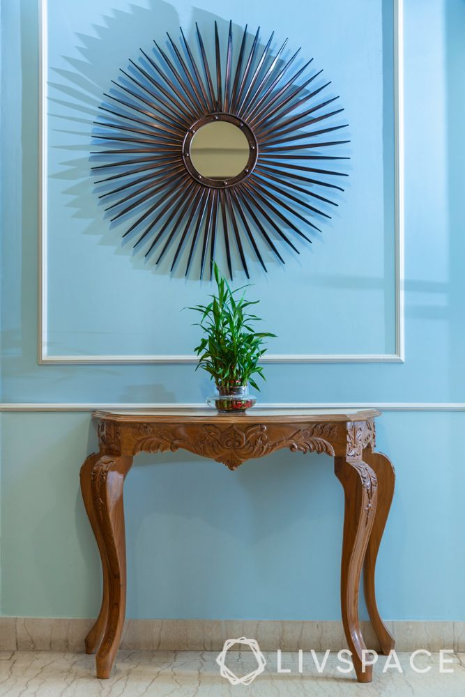 console table designs-wooden table-blue wall