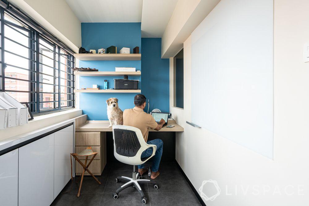 office-room-interior-design-minimalist-blue-wall-beige-furniture-white-paint