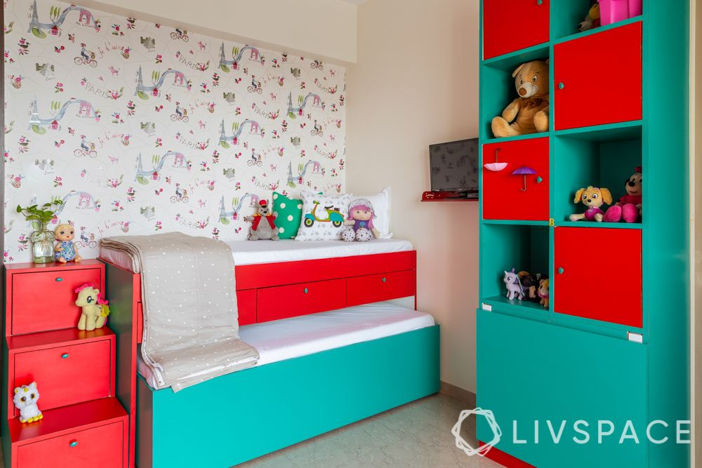 top interior designers in Mumbai-kids room-red and green-trundle bed-vertical storage