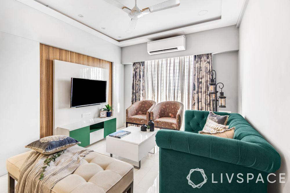 interiors designers in Mumbai-living room-emerald sofa-accent chairs-TV unit-centre table