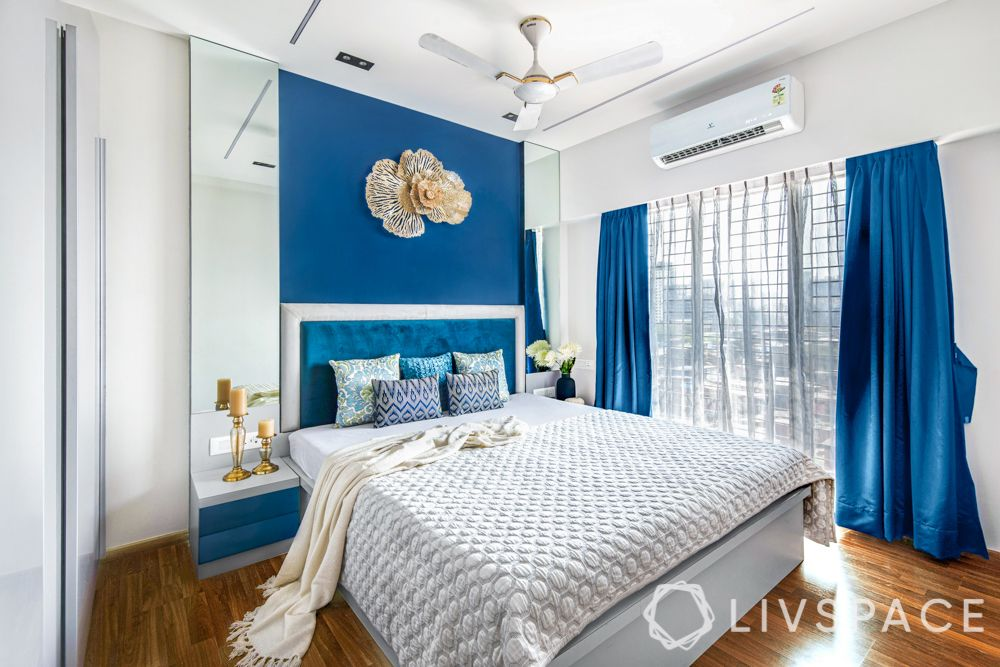 top interiors designers in Mumbai-bedroom-blue and gold theme