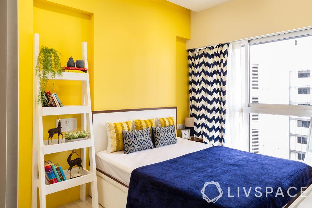 interiors designers in Mumbai-bedroom-yellow wall-ladder storage unit-bed