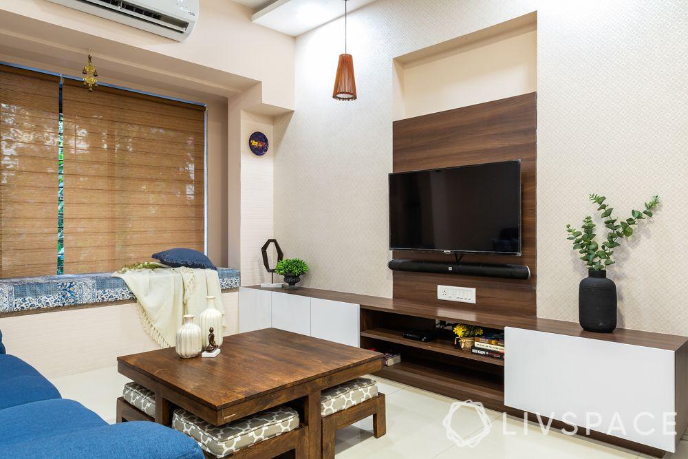 top interior designers in Mumbai-simple living room-wooden units-TV unit-window seating
