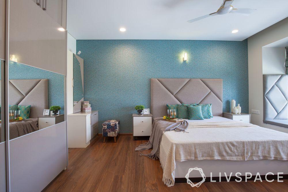 bedroom design-blue wallpaper-grey headboard