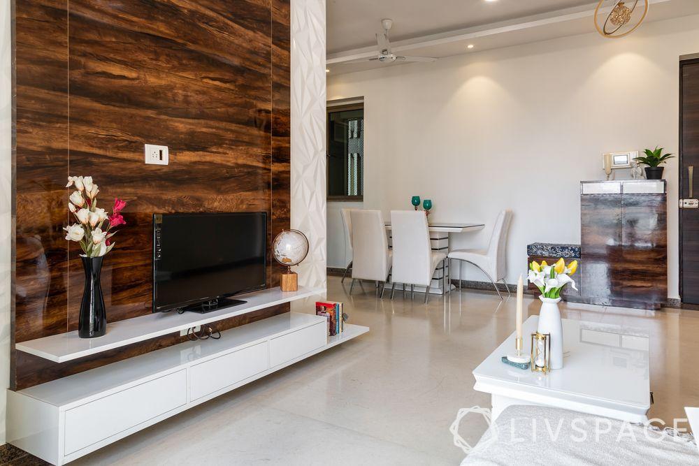 mumbai house-living room-glossy TV unit-wooden panelling