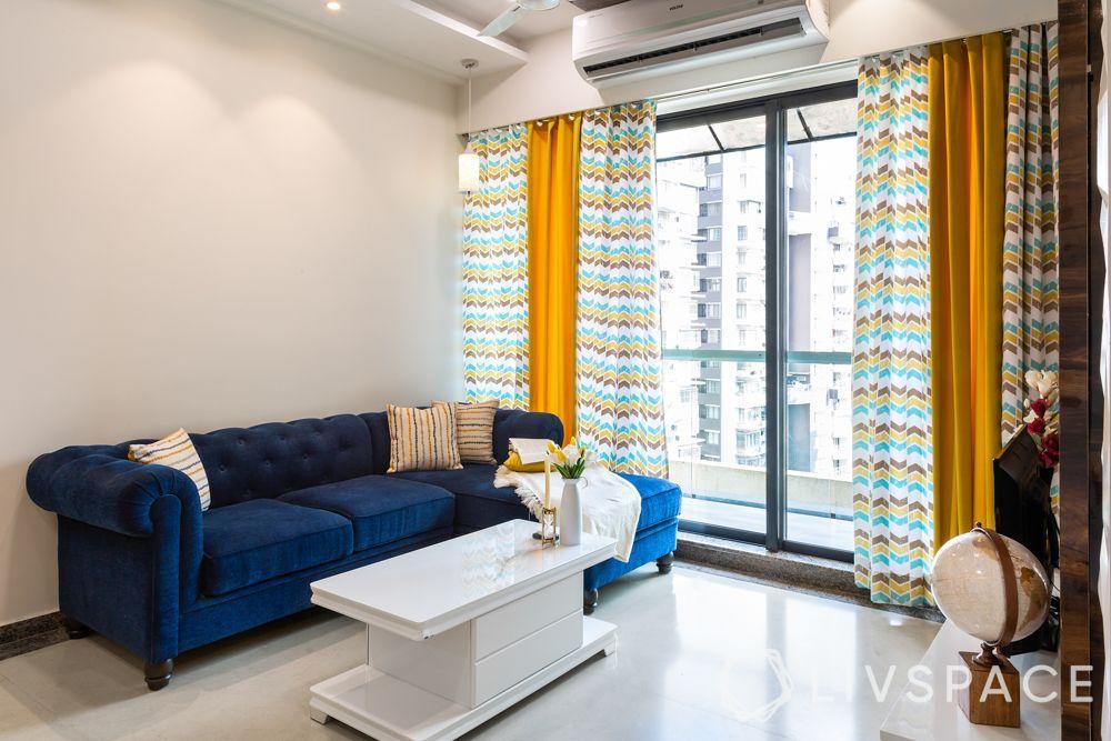 mumbai house-living room-blue sofa-centre table