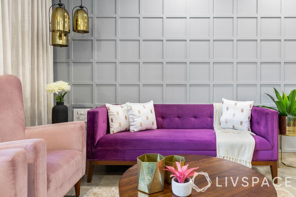 interior wall design-accent wall-wall moulding-purple sofa-grey wall