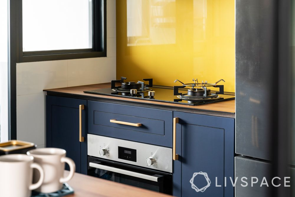 clean kitchen-blue kitchen-glass backsplash