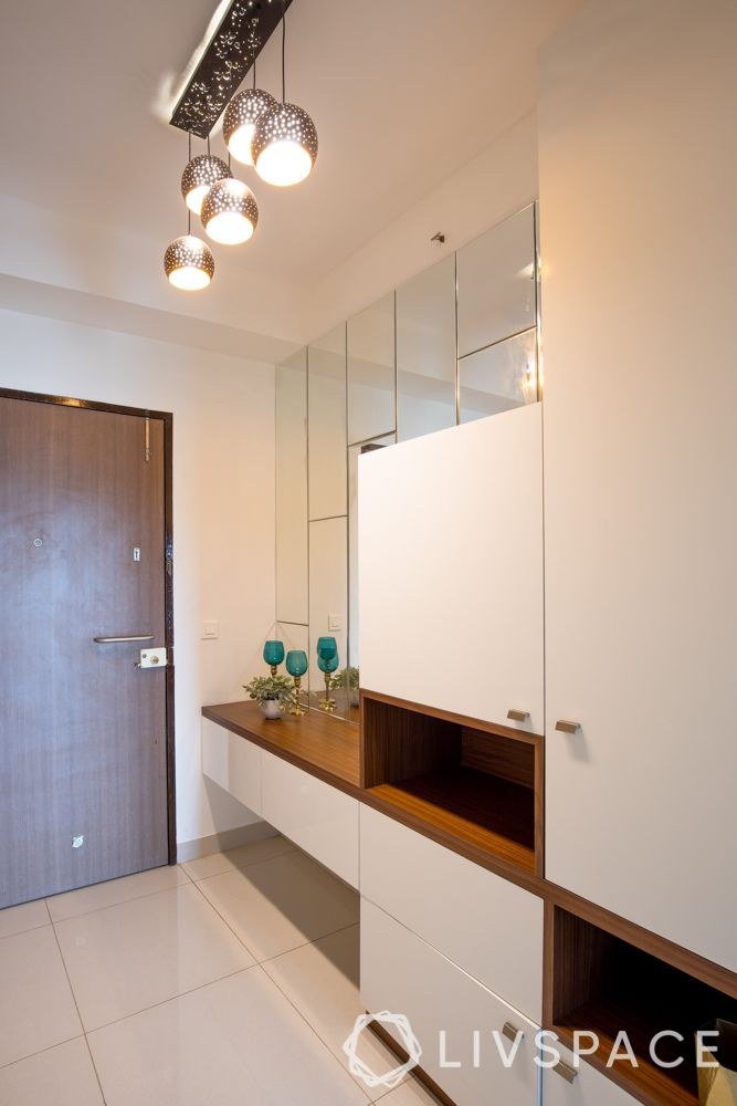 Alt text: 2bhk-in-Pune-foyer-wood-finish-storage-mirrors-display-console