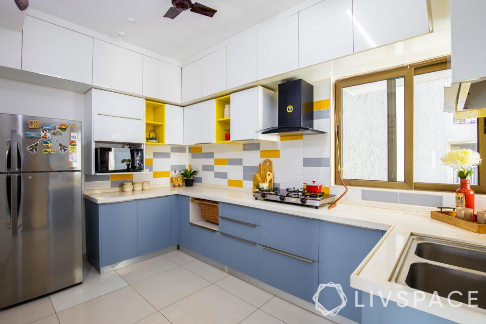 2bhk-in-Pune-kitchen-modular-membrane-finish-yellow-tiles-cabinets