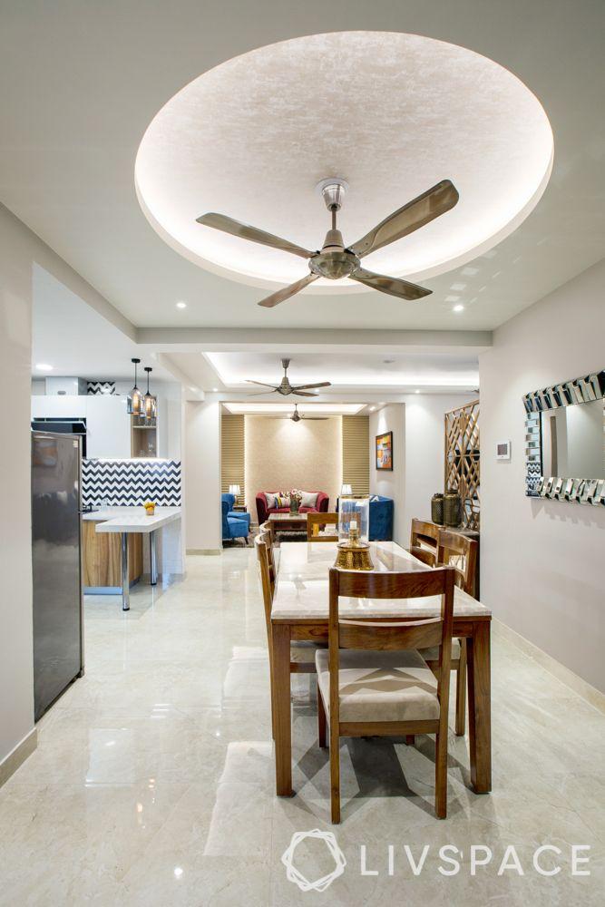 best false ceiling design-gypsum ceiling-light distribution-circular ceiling-dining room