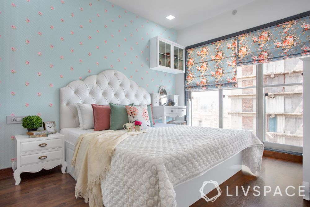 bedroom design for girls-blue and white bedroom-button tufted headboard-floral wallpaper