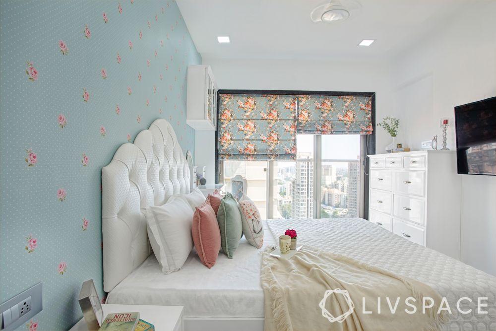 big girl bedroom ideas-tufted headboard-blue floral wallpaper