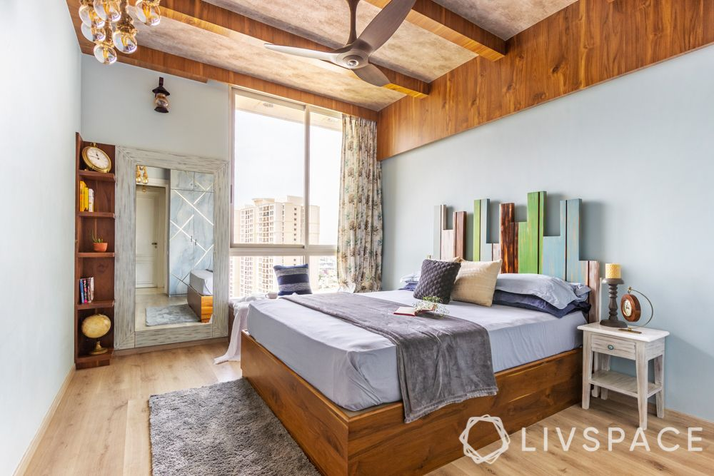 bedroom design for girls-rustic theme-distressed headboard-wooden rafters-wooden corner unit