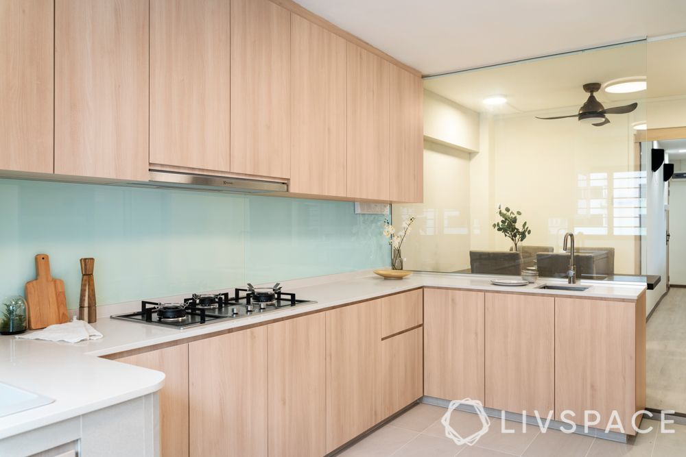 modular-kitchen-design-l-shape-small-kitchen-wooden-blue-glass-backsplsh