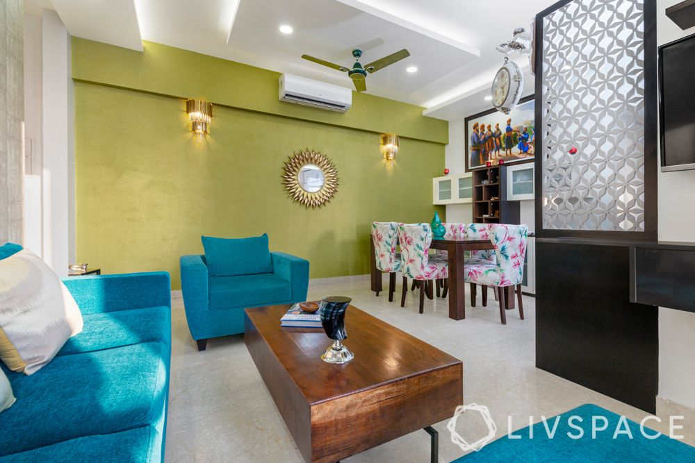budget home-living room-jaali partition-blue sofa