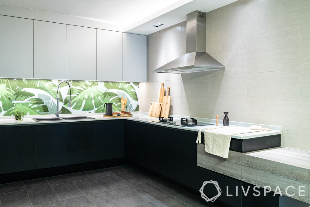 modular-kitchen-design-l-shape-large-kitchen-black-white-leaf-motifs-extended-workspace