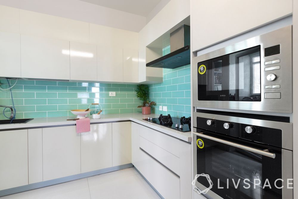 modular-kitchen-design-l-shape-small-kitchen-white-cyan-tiles-backsplash