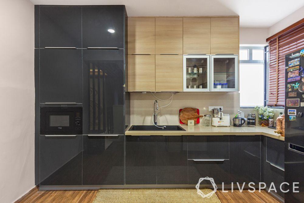 modular-kitchen-design-l-shape-small-kitchen-black-tall-units-storage-floor-space