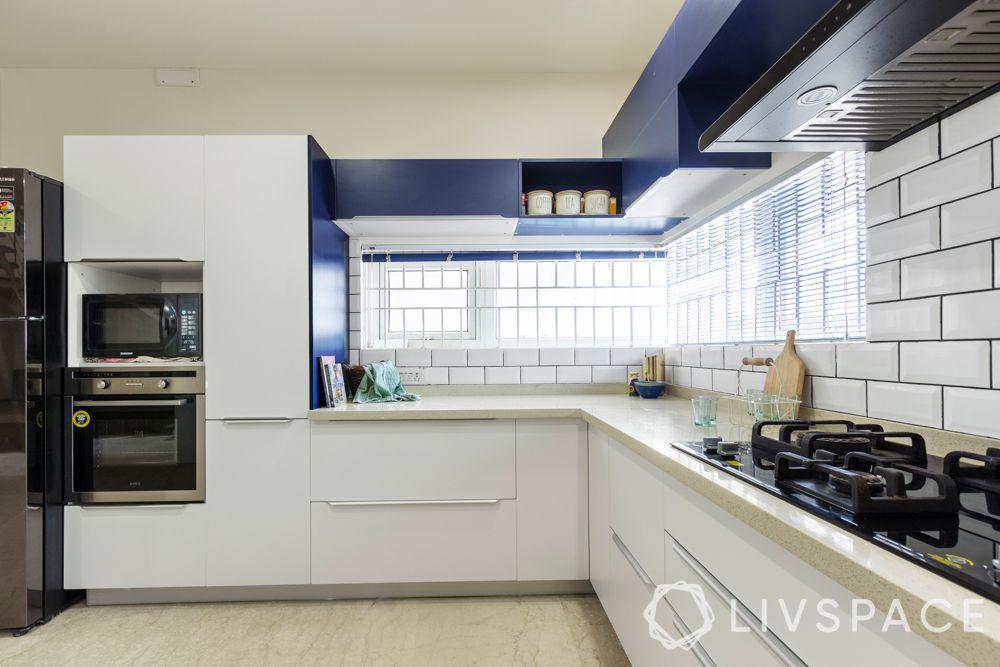 modular-kitchen-design-l-shape-large-kitchen-blue-white-appliance-tall-unit