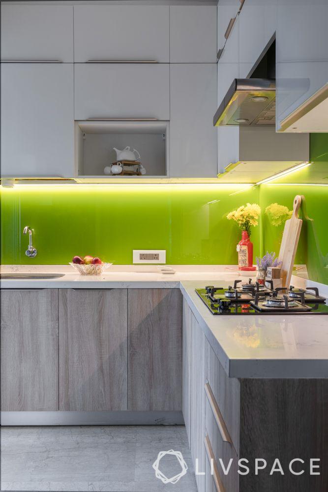modular-kitchen-design-l-shape-small-kitchen-green-backsplash-white-countertop
