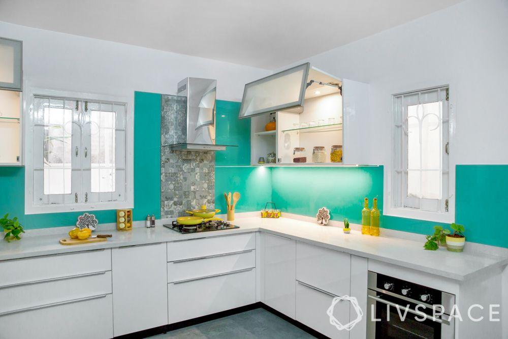modular-kitchen-design-l-shape-medium-kitchen-white-cabinet-mechanisms-blue-backsplash