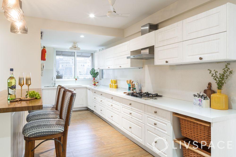 modular-kitchen-design-l-shape-large-kitchen-white-cabinets-wooden-flooring