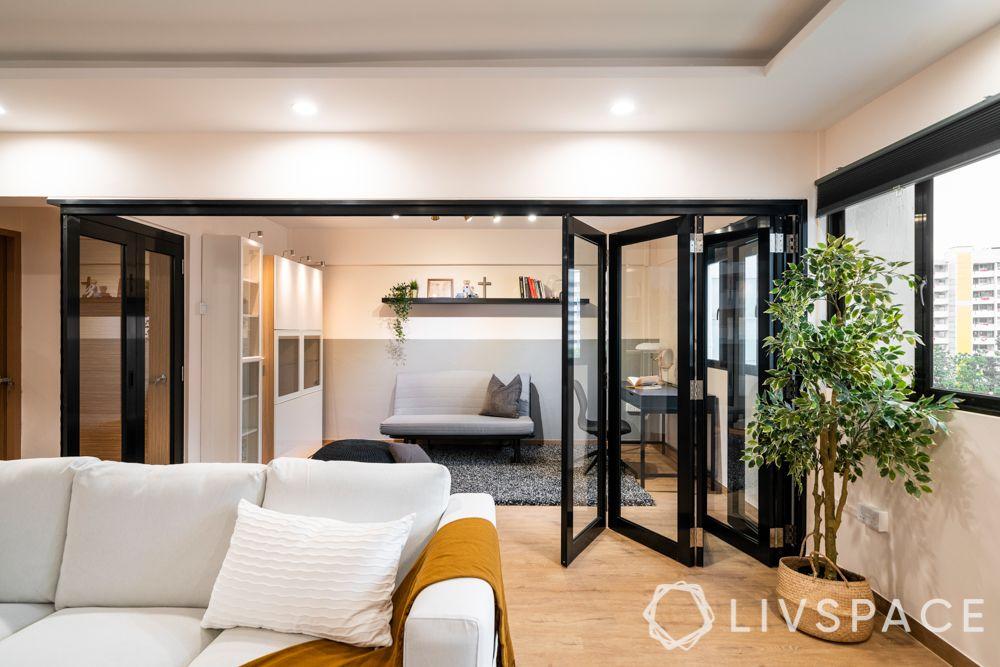 door-designs-folding-doors-black-frame-white-couch