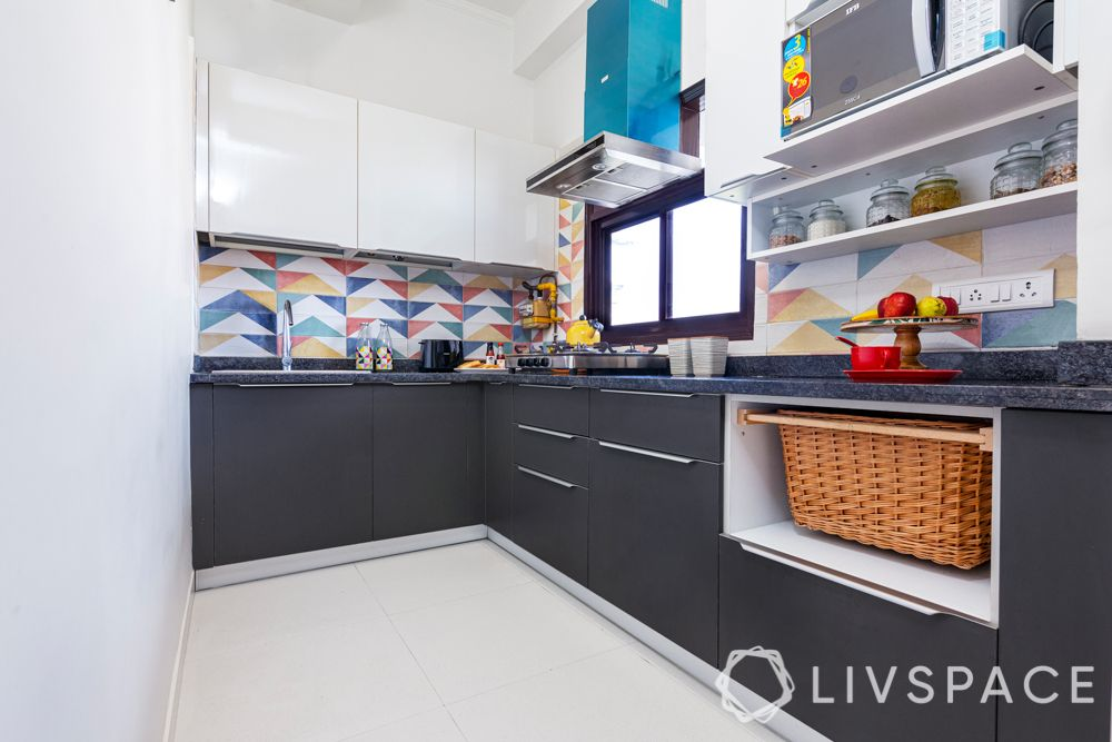small kitchen design Indian style-small kitchen-double toned cabinets-wicker basket-colourful backsplash