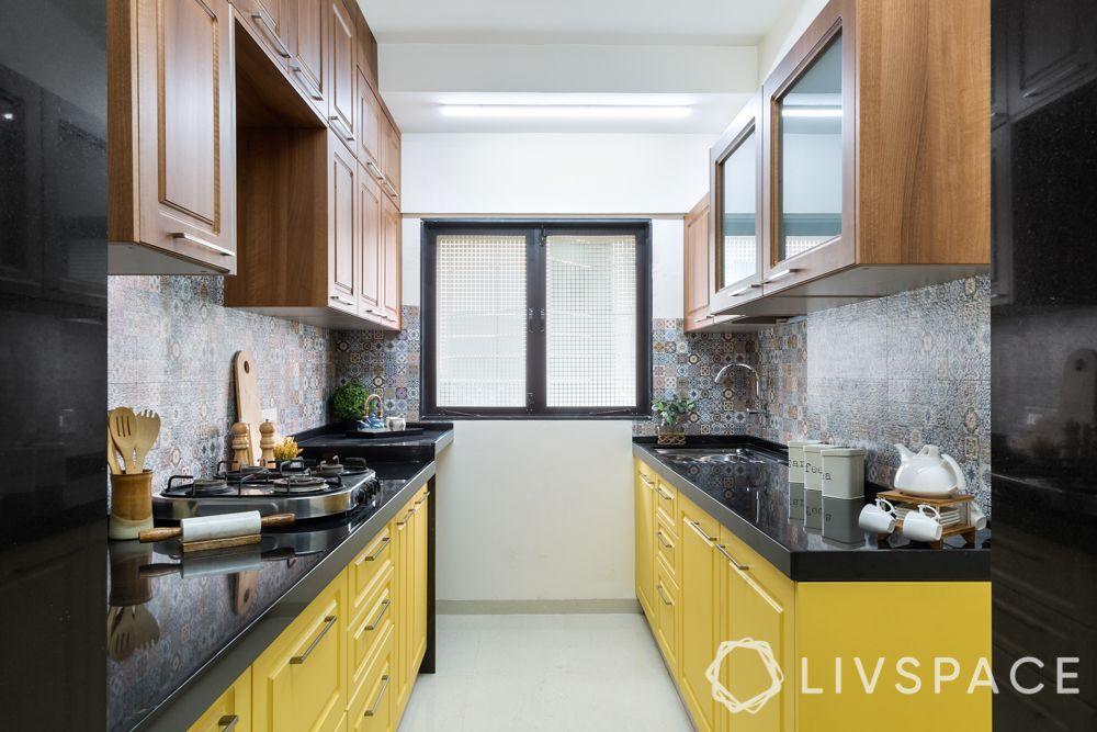 small kitchen design Indian style-vastu friendly kitchen-yellow cabinets-hob-sink
