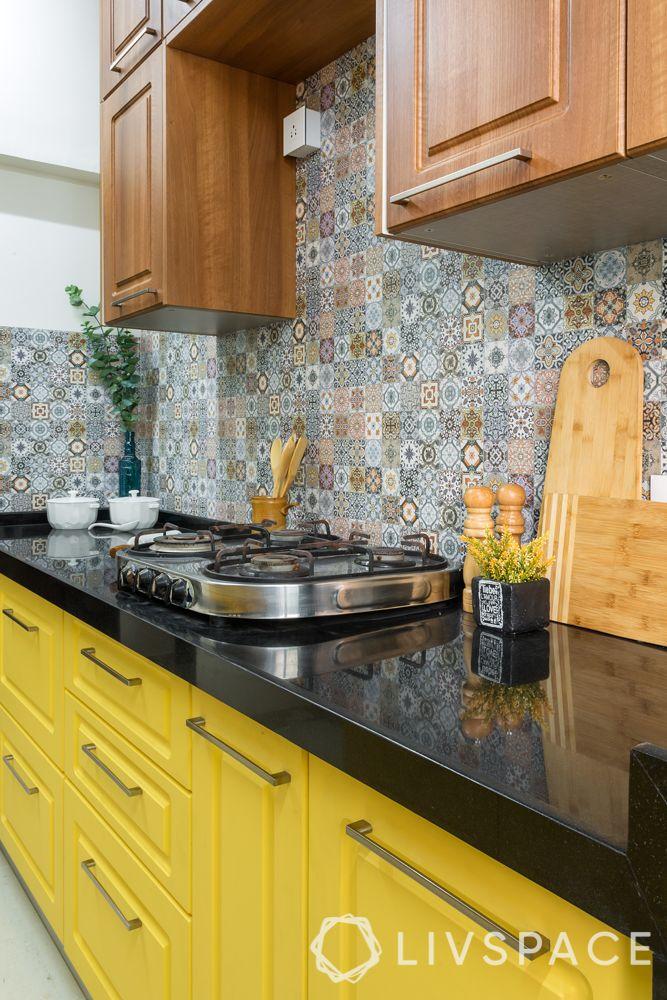 Indian style kitchen design images-black countertop-yellow cabinets-backsplash