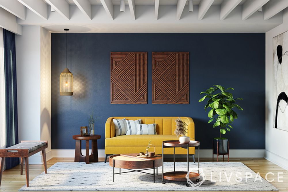 wooden false ceiling-living room-white modular rafters-blue accent wall-yellow sofa