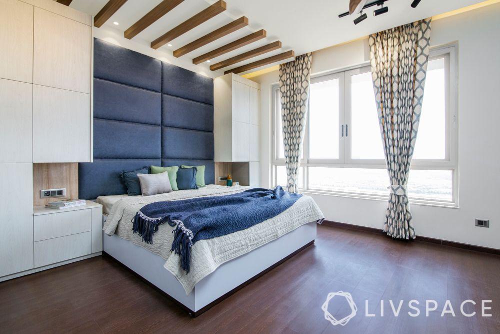 wooden flooring-laminated wood floor-bed-wooden rafters-headboard