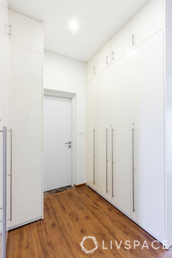 wooden flooring India-white wardrobe