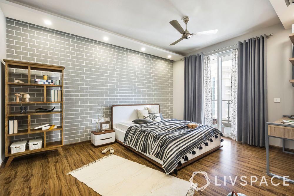 top interior designers in Delhi-Scandinavian interiors-bedroom-industrial wall-wooden finish furniture