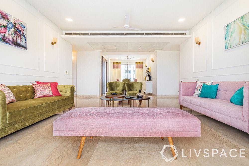 interior designers Delhi-pastel themed living room-dusty pink sofa-dusty pink Zuri bench-olive green sofa-wall trims