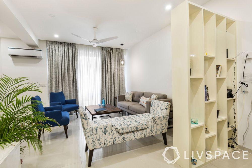 interior designers Delhi-living room-white walls-beige partition-beige bench-blue chairs