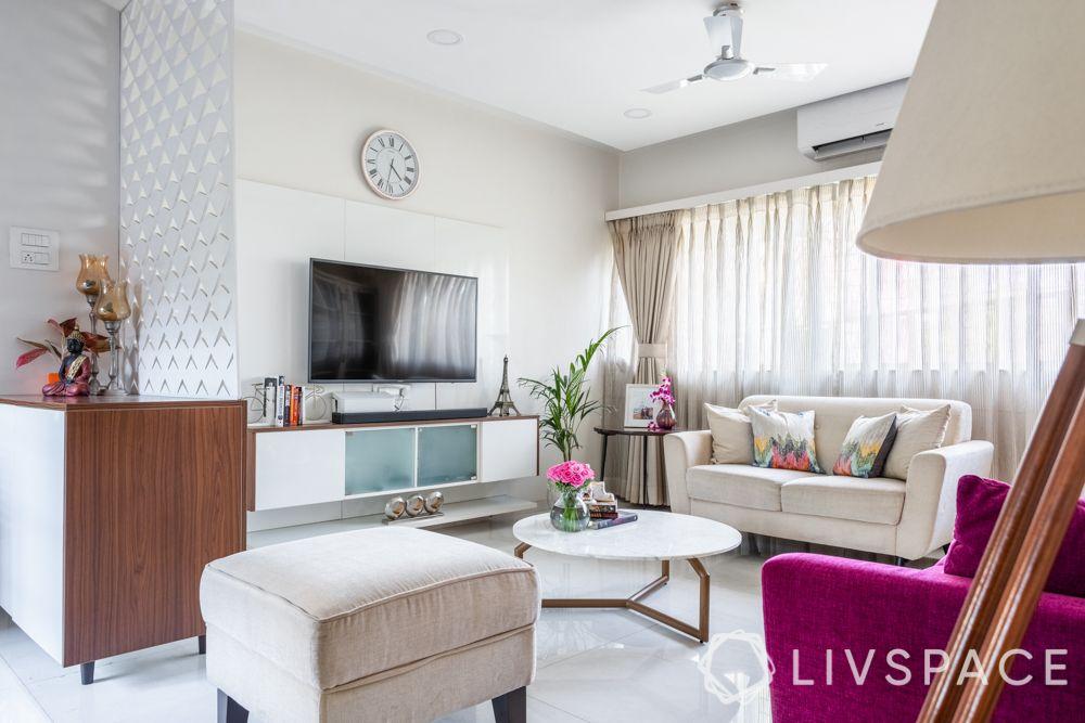 living-room-ideas-floating-furniture-white-walls-purple-sofa-TV